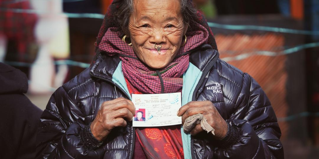 An elderly woman in Gorkha district gets her citizenship certificate for the first time